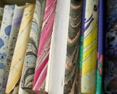 Image of books that have be bound with Marbling effect